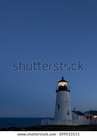 Pemaquid lighthouse glows in the night sky. - stock photo