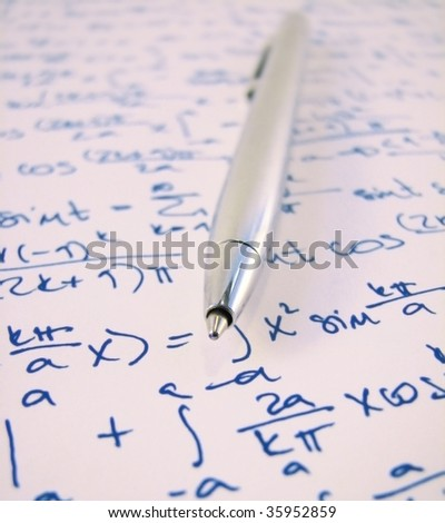 Pen and a mathematical exercise  (calculations are real and solved correctly) - stock photo