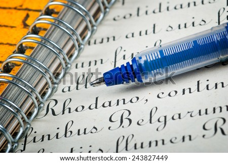 Pen and ancient latin calligraphic text - letter - stock photo