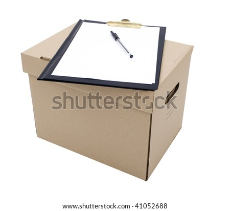 pen and blank clipboard lying on cardboard box with handle