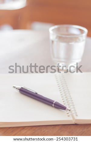 Pen and blank spiral notebook on wooden table, stock photo - stock photo