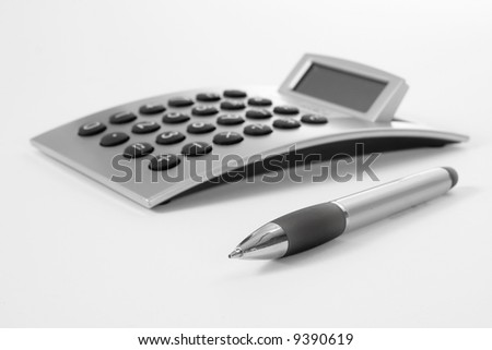 Pen and calculator (business background) - stock photo