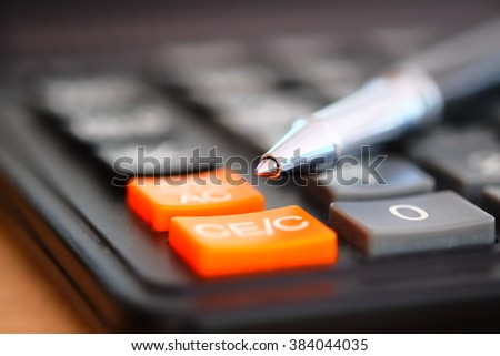 pen and calculator. business concept. (Macro with blur and soft focus) - stock photo
