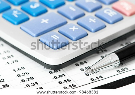 pen and calculator on business paper - stock photo
