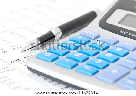 pen and calculator on chart  - stock photo