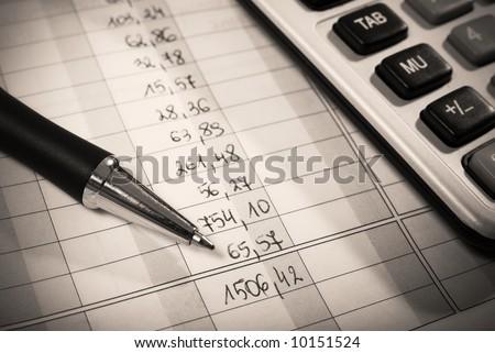 Pen and calculator on financial document. Macro. Shallow DOF. - stock photo