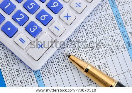 Pen and calculator on sheet with numbers