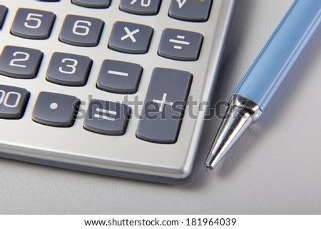 pen and calculator on the desk - stock photo