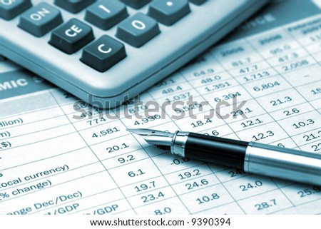 pen and calculator on the financial table - stock photo