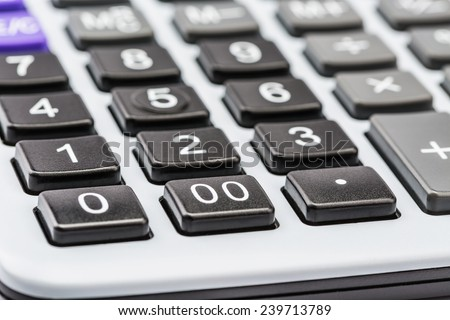 Pen and calculator, picture from perspective - stock photo