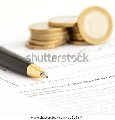 pen and euro coins - stock photo
