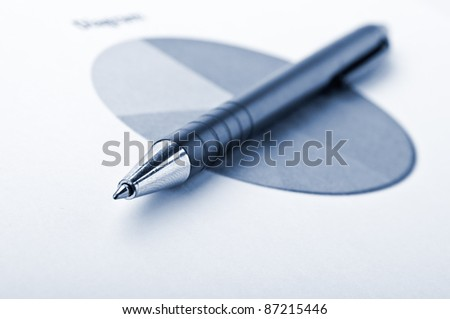 pen and finance diagram on a table in office - stock photo