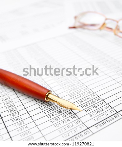 Pen and Glasses on documents. - stock photo