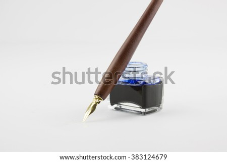 Pen and ink isolated on white - stock photo