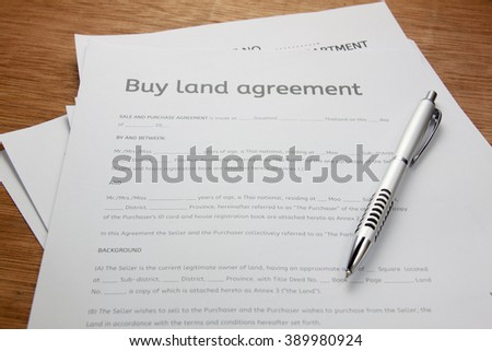 Pen Land Contract Form On Wood Stock Photo   Shutterstock