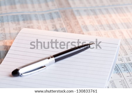pen and note book on financial background