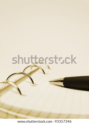 Pen and notepad - abstract business background - stock photo