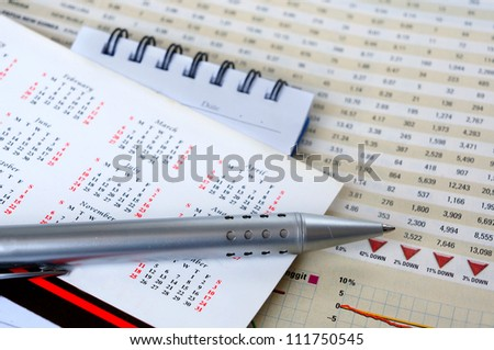 Pen and notepad on calendar for business concept - stock photo