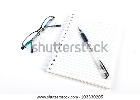 Pen and notepad with glasses