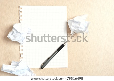 Pen and paper on desk - stock photo