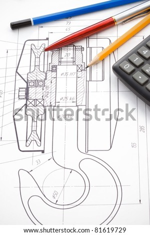 pen and pencil, calculator on hook crane drafting - stock photo