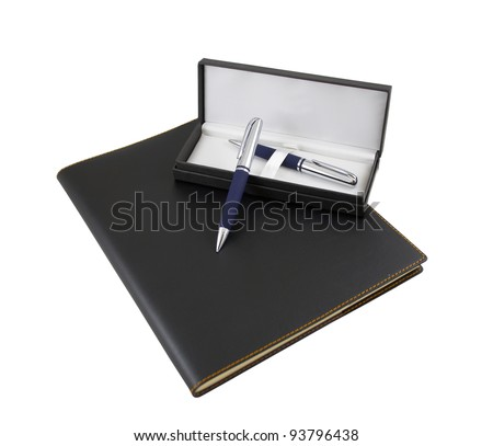 Pen and pencil in a gift box on top of black luxury organizer with leather cover isolated on white background
