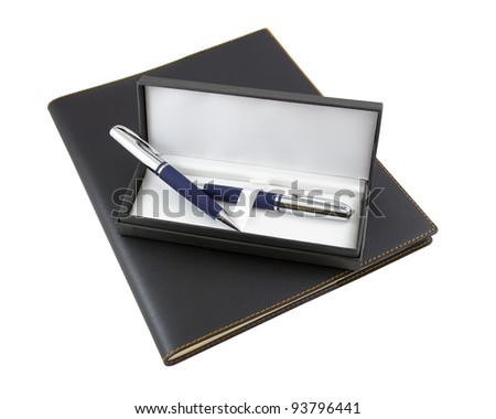 Pen and pencil in a gift box on top of closed black luxury organizer with leather cover, isolated on white background