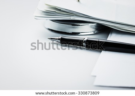 Pen and receipts in paper nail - stock photo