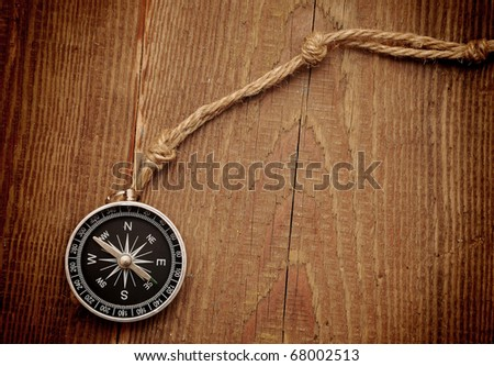 pen and rope on wood background - stock photo