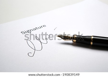 pen and signature on a white closeup