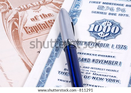 Pen and Stock Certificates - stock photo