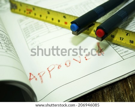 pen and tape measure on  shop drawing - stock photo