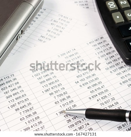 Pen, calculator and business graph  - stock photo