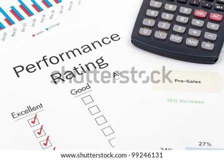 Pen, Calculator and Performance Rating Form on desktop in business office. - stock photo