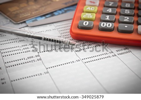 pen ,calculator, credit card on account book. selective focus. - stock photo