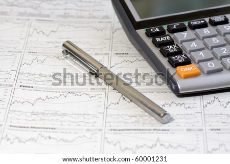 Pen, Calculator On A Financial Newpaper. Shot in studio.