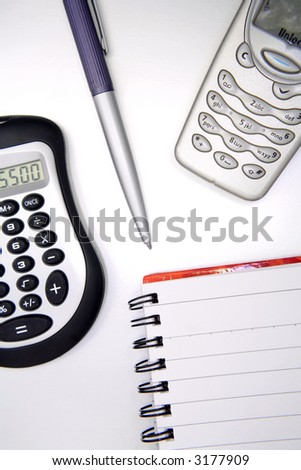 Pen,calculator,phone and notebook - stock photo