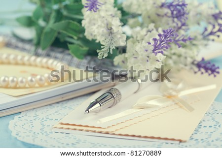 pen, cards, flowers and beads - stock photo