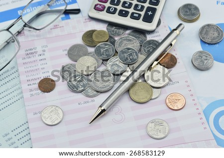 Pen, coin, glasses and calculator on saving book, accounting background - stock photo