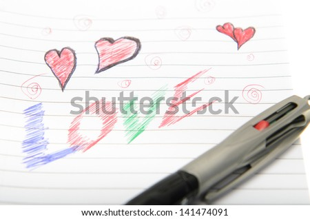 Pen drawing love doodle in a notebook - stock photo