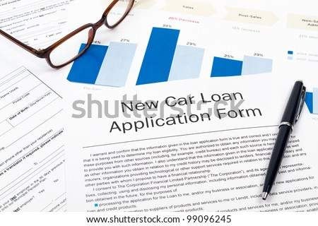 Pen, Glasses and New Car Loan Application Form on desktop in business office. - stock photo