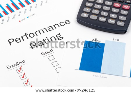 Pen, Glasses and Performance Rating Form on desktop in business office. - stock photo
