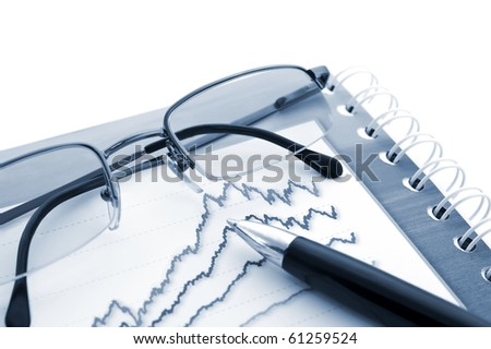 Pen, Glasses and stats on a white background.