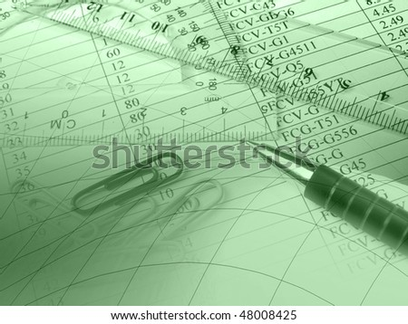 Pen, graph and rulers against the table - collage (green).