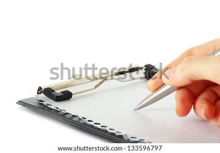 pen in hand isolated on wood background