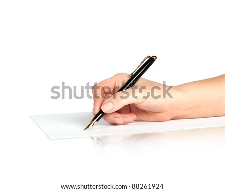 pen in hand writing on the page with reflection