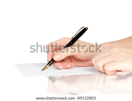 pen in hand writing on the page with reflection - stock photo