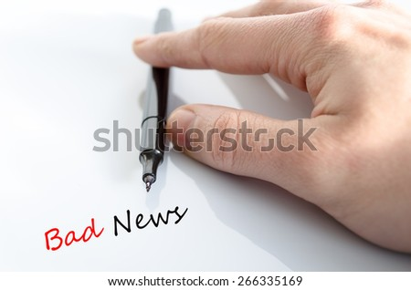 Pen in the hand isolated over white background and text concept Bad News - stock photo
