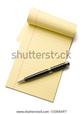 Pen laying on an opened note pad isolated on white background. - stock photo