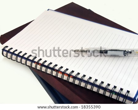 Pen laying on empty notebook - stock photo